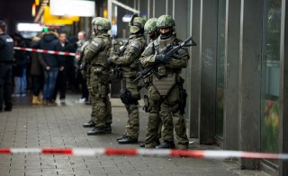 """Police is pictured outside the Munich train station on December 31, 2015.  German police said Thursday that they had """"indications that a terror attack"""" was being planned for New Year's Eve in the southern city of Munich, as they called on the public to avoid large gatherings and two key train stations. / AFP / dpa / Sven Hoppe / Germany OUT"""