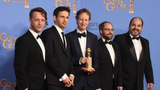 """Director Laszlo Nemes (C) and actor Geza Rohrig (2L) and other members of the """"Son of Saul"""" team pose with the award for Best Foreign Language film for """"Son of Saul,"""" in the press room at the 73nd annual Golden Globe Awards, January 10, 2016, at the Beverly Hilton Hotel in Beverly Hills, California. AFP PHOTO / FREDERIC J. BROWN / AFP / FREDERIC J BROWN"""