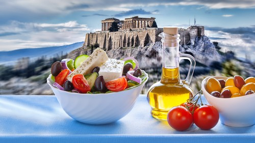 Famous Acropolis with Greek salad in Athens, Greece