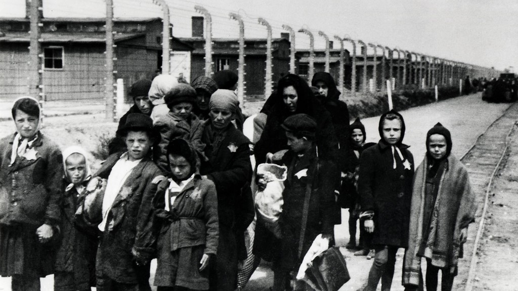 The arrival of Hungarian Jews in Auschwitz-Birkenau, in German-occupied Poland, June 1944. Between May 2nd and July 9th, more than 430,000 Hungarian Jews were deported to Auschwitz. They are wearing the star emblem which identifies them as Jews. (Photo by Galerie Bilderwelt/Getty Images)