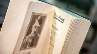 ILLUSTRATION -  An opened page of the original edition of Hitler's inflammatory pamphlet  'Mein Kampf' shows a portrait of national socialist dictator Adolf Hitler, in a bookshop in Frankfurt, Germany, 7 January 2016. the annotated edition of the 1924 original publication was published in Germany on 8 January 2016. Photo: Alexander Heinl/dpa