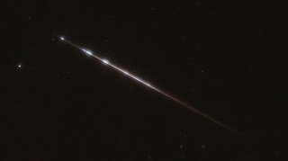Through lens fog, this still shows breakup by light bursts.