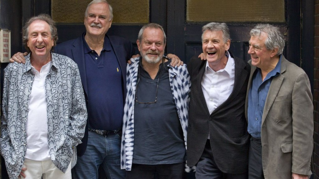 British comedy troupe Monty Python, (L-R) Eric Idle, John Cleese, Terry Gilliam, Michael Palin, and Terry Jones pose for a photograph at the back door to the London Palladium in central London on June 30, 2014. The comics appeared at a press conference on the eve of their reunion shows at London's O2 arena. AFP PHOTO/JUSTIN TALLIS / AFP / JUSTIN TALLIS