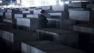 A Rabbi stands in front of  a cement stele of the Holocaust Memorial to the Murdered Jews of Europe during a march from the Brandenburg Gate on November 11, 2013 in Berlin.  More than 200 Rabbis from 30 different countries took part in a Silent Memorial  to mark the 75th anniversary of the Kristallnacht (Night of Broken Glass).    AFP PHOTO / JOHANNES EISELE / AFP / JOHANNES EISELE
