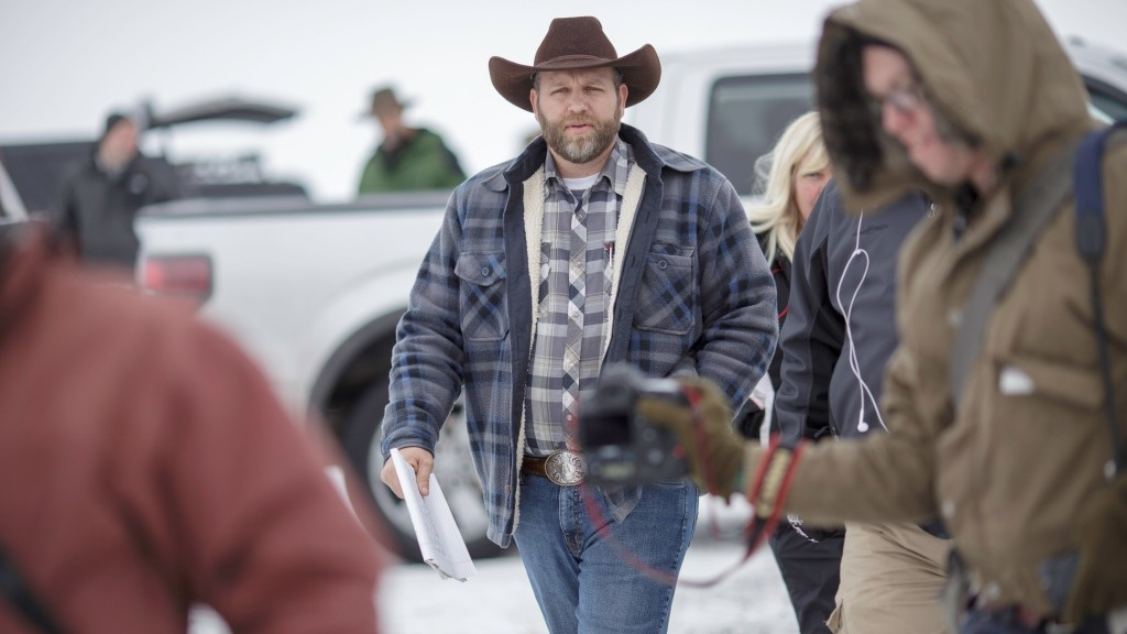 Ammon Bundy, leader of an armed anti-government militia, leaves after making a statement at a news conference at the Malheur National Wildlife Refuge Headquarters near Burns, Oregon January 5, 2016. The occupation of a wildlife refuge by armed protesters in Oregon reflects a decades-old dispute over land rights in the United States, where local communities have increasingly sought to take back federal land. While the standoff in rural Oregon was prompted by the jailing of two ranchers convicted of arson, experts say the issue at the core of the dispute runs much deeper and concerns grazing or timber rights as well as permits to work mines on government land in Western states. AFP PHOTO / ROB KERR / AFP / ROB KERR