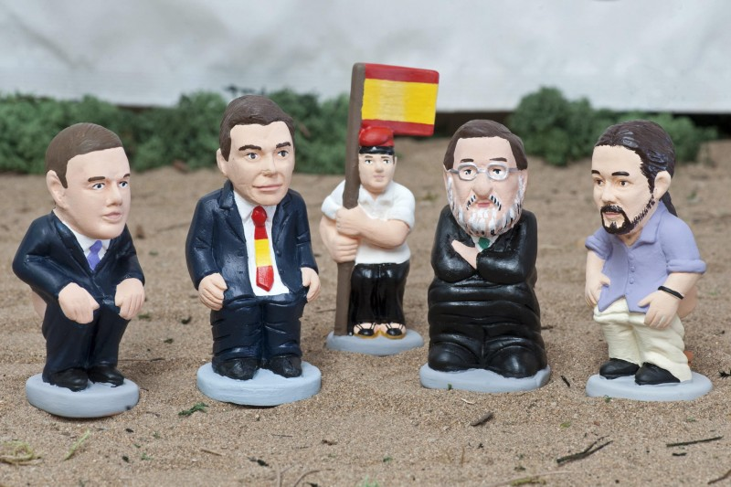 epa05010484 Little figures of Catalonian traditional Christmas crib called 'caganer' (the defecator) picturing Spanish political leaders (L-R): Albert Rivera of Ciudadanos party; Socialist Party's leader Pedro Sanchez, a traditional Catalonian farmer holding a Spanish flag, Spanish Prime Minister, Mariano Rajoy and Podemos' leader, Pablo Iglesias during the launching by its manufacturer caganer.com in Torroella de Montgri, Girona, Catalonia, northeastern Spain, 04 November 2015. The 'caganer' is a traditional figure of the Catalonian nativity scenes for at least two centuries. EPA/ROBIN TOWNSEND