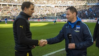 Dortmund head coach Thomas Tuchel (L) shakes hands with Hertha Berlin's Hungarian head coach Pal Dardai prior to the German first division Bundesliga football match Berlin vs Dortmund at the Olympic stadium in Berlin on February 6, 2016.   / AFP / ODD ANDERSEN / RESTRICTIONS: DURING MATCH TIME: DFL RULES TO LIMIT THE ONLINE USAGE TO 15 PICTURES PER MATCH AND FORBID IMAGE SEQUENCES TO SIMULATE VIDEO. == RESTRICTED TO EDITORIAL USE == FOR FURTHER QUERIES PLEASE CONTACT DFL DIRECTLY AT + 49 69 650050