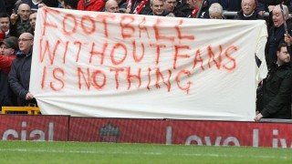 (FILES) This file photo taken on February 6, 2016 shows Liverpool fans holding a banner as they protest against the recently announced rise in ticket prices during the English Premier League football match between Liverpool and Sunderland at Anfield in Liverpool, north west England. Liverpool's owners on Wednesday apologised and scrapped controversial plans to hike Anfield ticket prices after 10,000 fans walked out of the ground in protest at the weekend.Principal owner John W Henry and chairman Tom Werner acted after legions of angry Reds fans stormed out of the ground in the 77th minute of Saturday's home game against Sunderland.  / AFP / LINDSEY PARNABY