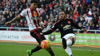 Sunderland's US defender DeAndre Yedlin (L) vies with Manchester United's Dutch midfielder Memphis Depay during the English Premier League football match between Sunderland and Manchester United at the Stadium of Light in Sunderland, northeast England on February 13, 2016. / AFP / OLI SCARFF / RESTRICTED TO EDITORIAL USE. No use with unauthorized audio, video, data, fixture lists, club/league logos or 'live' services. Online in-match use limited to 75 images, no video emulation. No use in betting, games or single club/league/player publications.  /