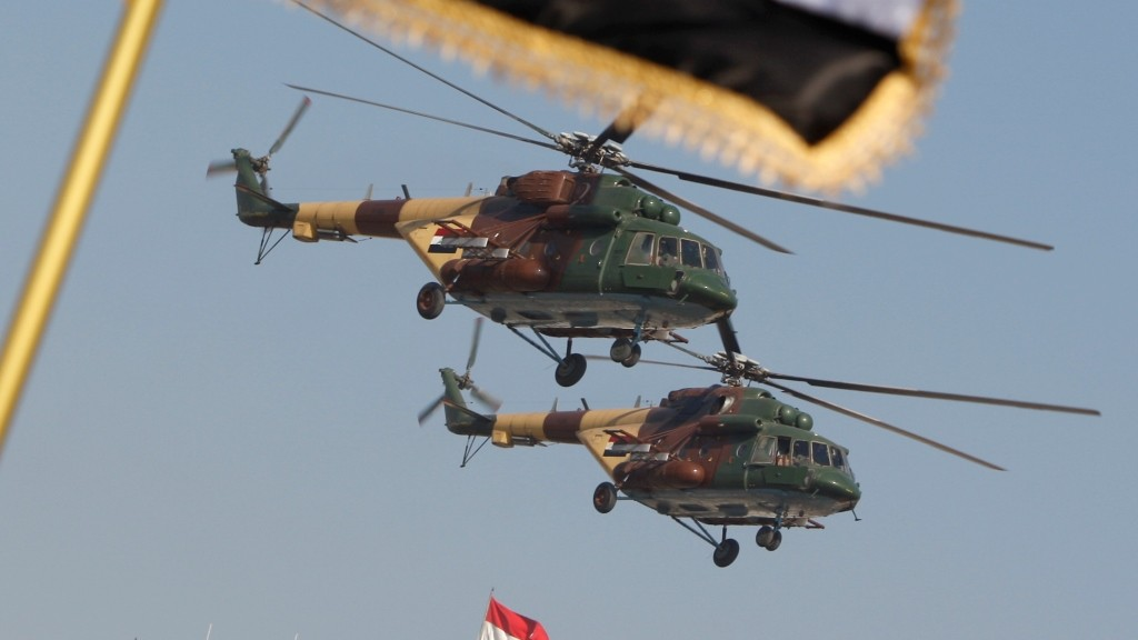 """(FILES) This file photo taken on January 06, 2010 shows Iraqi army Russian-made MI-17 helicopters flying during a parade in central Baghdad.  A Russian-made Iraqi military helicopter crashed south of Baghdad due to a """"technical problem"""" on February 16, 2016, killing at least nine people, officers said.    / AFP / AHMAD AL-RUBAYE"""