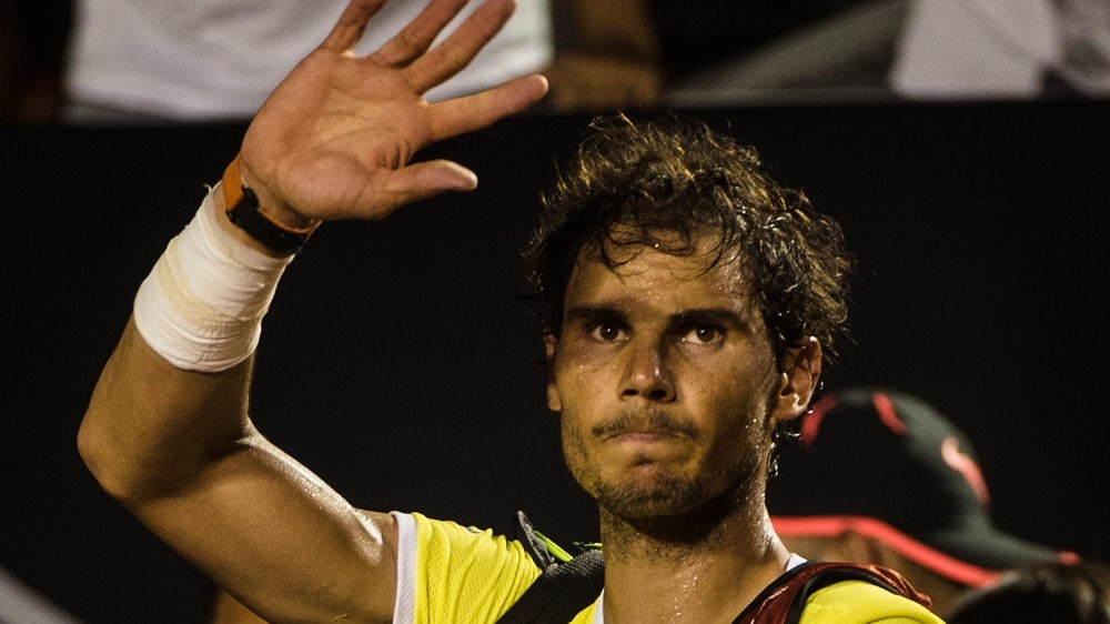 Rafael Nadal of Spain reacts to crowd after losing against Pablo Cuevas of Uruguay in the men's singles semi-final of the 2016 Rio Open tennis tournament in Rio de Janeiro, Brazil, on Februrary 21, 2016. / AFP / YASUYOSHI CHIBA