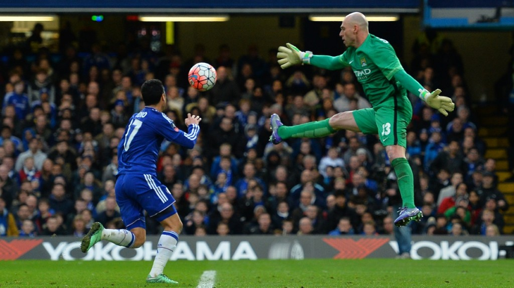Manchester CIty's Argentinian goalkeeper Willy Caballero (R) leaps as Chelsea's Spanish midfielder Pedro (L) goes through but is ruled off-side during the English FA Cup fifth round football match between Chelsea and Manchester City at Stamford Bridge in London on February 21, 2016.  / AFP / GLYN KIRK / RESTRICTED TO EDITORIAL USE. No use with unauthorized audio, video, data, fixture lists, club/league logos or 'live' services. Online in-match use limited to 75 images, no video emulation. No use in betting, games or single club/league/player publications.  /