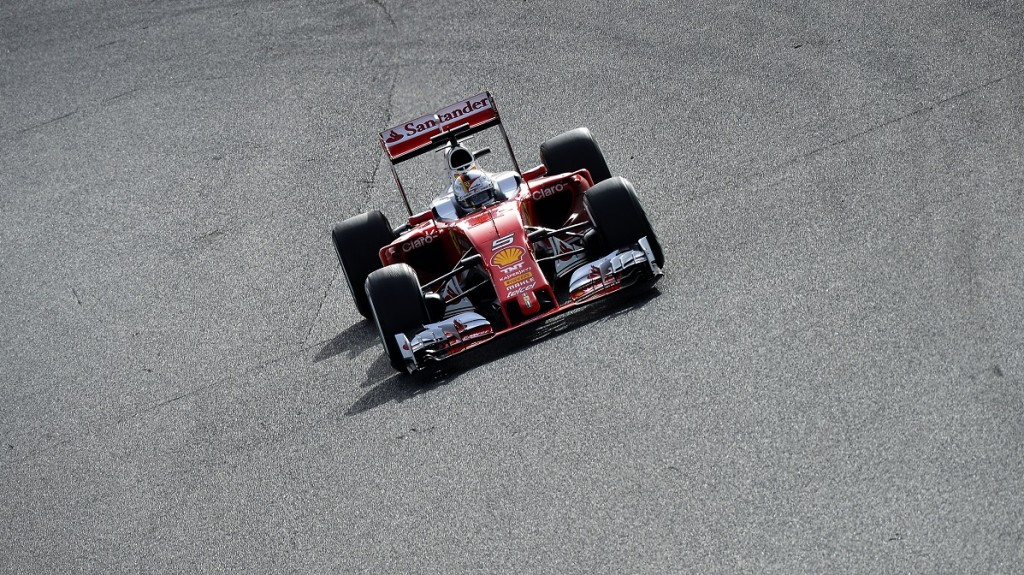 Ferrari's German driver Sebastian Vettel drives at the Circuit de Catalunya on February 23, 2016 in Montmelo on the outskirts of Barcelona on the second test day of the Formula One Grand Prix season. / AFP / JOSE JORDAN