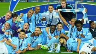 Manchester CIty players pose with the League Cup during the presentation after Manchester City won the penalty shoot-out to win the English League Cup final football match between Liverpool and Manchester City at Wembley Stadium in London on February 28, 2016. / AFP / GLYN KIRK / RESTRICTED TO EDITORIAL USE. No use with unauthorized audio, video, data, fixture lists, club/league logos or 'live' services. Online in-match use limited to 75 images, no video emulation. No use in betting, games or single club/league/player publications.  /