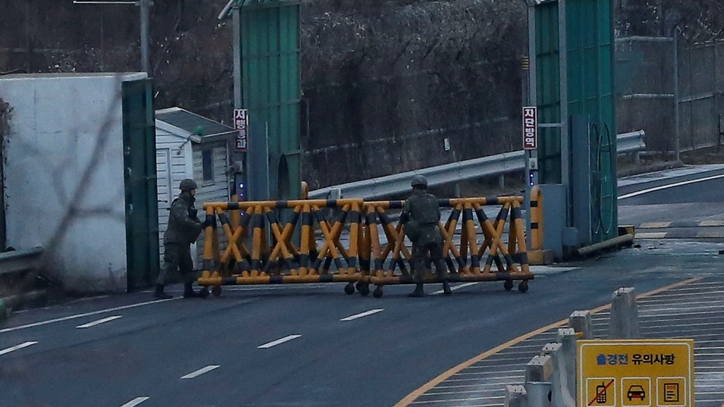 South Korean soldiers set barricades on the road leading to the Kaesong joint industrial zone at a checkpoint of the CIQ immigration centre near the Demilitarized Zone (DMZ) dividing the two Koreas, in Paju on February 11, 2016. North Korea on February 11 ordered the immediate expulsion of all South Koreans from the jointly-run Kaesong industrial zone and the seizure of their factory assets in response to Seoul's decision to shut down the complex. REPUBLIC OF KOREA OUT  NO ARCHIVES  RESTRICTED TO SUBSCRIPTION USE     AFP PHOTO / YONHAP / AFP / YONHAP / YONHAP