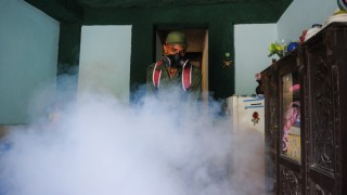 A member of the Cuban army fumigates against the Aedes aegypti mosquito to prevent the spread of zika, chikungunya and dengue, in Havana, on February 23, 2016. Cuban President Raul Castro announced Monday that 9,200 troops and police have been mobilized in a campaign to eliminate mosquitoes and protect the country against the Zika virus. Cuba has not officially recorded any cases of the mosquito-borne virus, which is strongly suspected of causing serious birth defects in babies born to infected mothers. But 28 countries and territories in the Americas and the Caribbean have reported cases of active Zika transmission, with 1.5 million in Brazil, the hardest-hit country.  AFP PHOTO / YAMIL LAGE / AFP / YAMIL LAGE