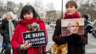 FRANCE, Paris: Women hold signs reading I am Jacqueline Sauvage and her photo during a demonstration demanding Jacqueline Sauvage's pardon in front of Bastille opera in Paris on January 23, 2016. Jacqueline Sauvage was sentenced to 10 years in jail after killing her violent husband. - CITIZENSIDE/DENIS PREZAT