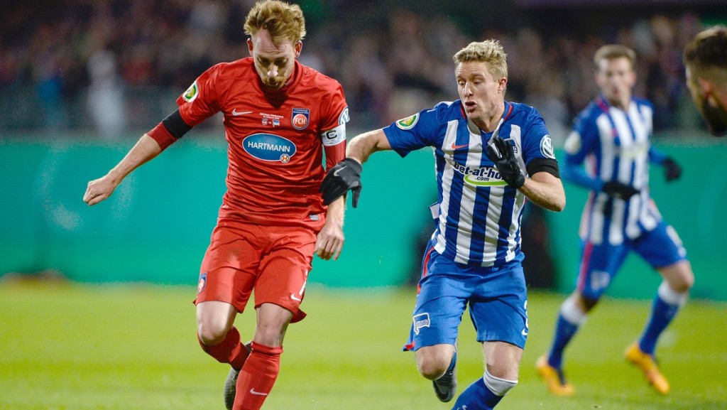 Heidenheim's Marc Schnatterer (L) in action against Berlin's Per Cilijan Skjelbred during the DFBCup quarterfinal soccer match between 1. FC Heidenheim and Hertha BSC at the Voith Arena in Heidenheim an der Brenz, Germany, 10February 2016. Photo: DANIELMAURER/dpa  (EMBARGOCONDITIONS- ATTENTION: The DFB prohibits the utilisation and publication of sequential pictures on the internet and other online media during the match (including half-time). ATTENTION: BLOCKING PERIOD! The DFB permits the further utilisation and publication of the pictures for mobile services (especially MMS) and for DVB-H and DMB only after the end of the match.)