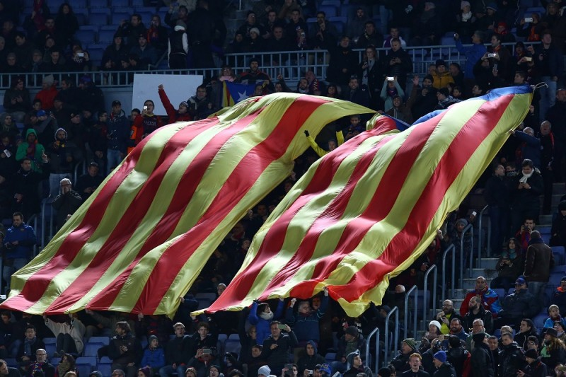 """Giants """"Esteladas"""" pro-independent Catalonia flags are pictured during the UEFA Champions League, Group E, football match between FC Barcelona and AS Roma on November 24, 2015 at Camp Nou stadium in Barcelona, Spain. Photo: Manuel Blondeau/AOP Press/DPPI"""