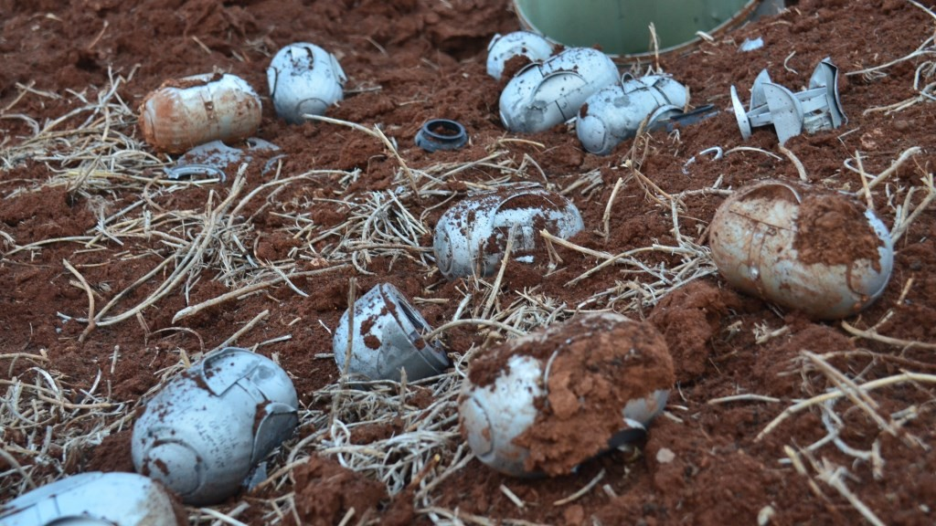 ALEPPO, SYRIA - DECEMBER 18: Alleged shrapnels of a cluster bomb are seen on the ground after the war crafts belonging to the Russian army attacked front line between Daesh and oppositions near Mare dictrict in Aleppo, Syria on December 18, 2015. Mamun Ebu Omer / Anadolu Agency