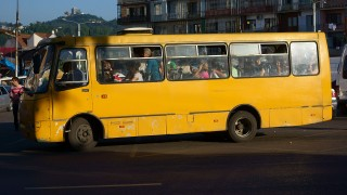 Crowded bus in down town Batumi in July evening