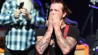 Jesse Hughes (R), the singer of US rock group Eagles of Death Metal, blows a kiss before the start of the concert at the Olympia concert hall in Paris, on February 16, 2016. Eagles of Death Metal, the Californian rock group who were playing at the Bataclan music hall in Paris when jihadist gunmen burst in and killed 90 people in November, returned to the French capital for a concert at the Olympia. AFP PHOTO / JOEL SAGET / AFP / JOEL SAGET