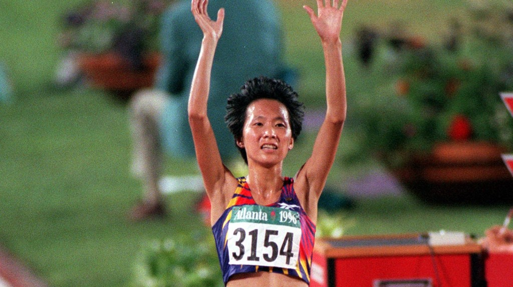 1996 Olympic Games, Atlanta, USA, Athletics, Women's 5000 Metres Final, China's Junxia Wang celebrates as she crosses the line to win the gold medal  (Photo by Popperfoto/Getty Images)