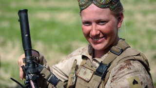 US Marine Corporal Jessica L. Williams of 2nd Battalion, 1st Marines Golf Company wears an Afghan cap during a patrol in Basabad, Helmand Province, on March 9, 2011. The US Marines deployed about 40 Female Marines in Helmand province and Nimruz for the Female Engagement Team (FET) programme to interact with Afghan civilians, specifically women and children. AFP PHOTO / ADEK BERRY / AFP / ADEK BERRY