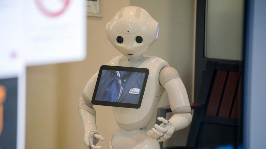 FRANCE, Nort-sur-Erdre: Programmable humanoid robot Pepper, developed by French robotics company Aldebaran Robotics informs travellers into Nort-sur-Erdre station, near Nantes, northwestern France, on February 5, 2016.  - CITIZENSIDE/RONAN HOUSSIN