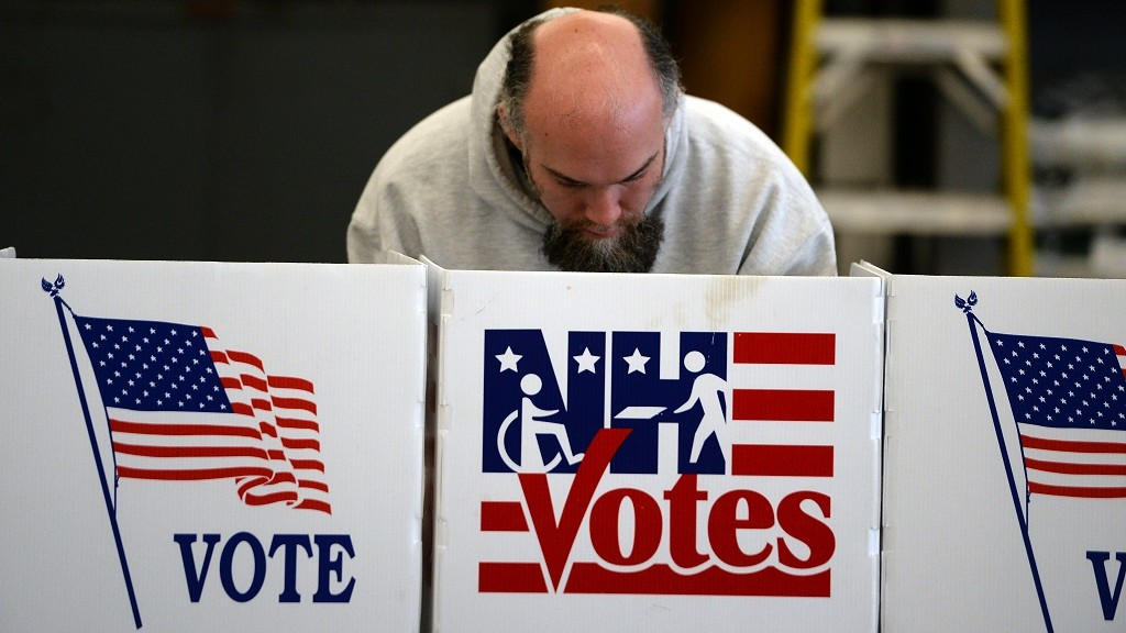 A man votes for the first US presidential primary at a fire station in Loudon, New Hampshire, on February 9, 2016. New Hampshire began voting on February 9 in the first US presidential primary with Republican Donald Trump calling on supporters to propel him to victory and Democrat Bernie Sanders primed to upstage Hillary Clinton. The northeastern state, home to just 1.3 million people, sets the tone for the primaries and could shake out a crowded Republican field of candidates pitting Trump and arch-conservative Senator Ted Cruz against more establishment candidates led by Senator Marco Rubio.  / AFP / JEWEL SAMAD