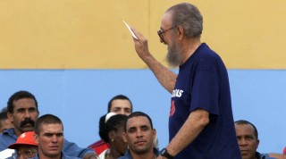 FILE - Cuban leader Fidel Castro and Cuban President Raul Castro's eldest brother, Ramon Castro, waves at baseball players from the country's Panamerican Games team on August 3, 1999 in Matanzas, Cuba. Ramon Castro, key figure of the ranching politics of the Cuban Revolution, died on February 23, 2016, at the age of 91, informed local TV. AFP PHOTO / ADALBERTO ROQUE / AFP / ADALBERTO ROQUE