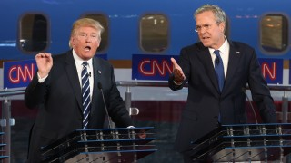 SIMI VALLEY, CA-SEPTEMBER. 16:  Republican presidential candidateJeb Bush and Donald Trump spar onstage during the Republican presidential debates at the Reagan Library in Simi Valley on September 16, 2015.  Fifteen Republican presidential candidates are participating in the second of presidential debates(Photo by Justin Sullivan/Getty Images)