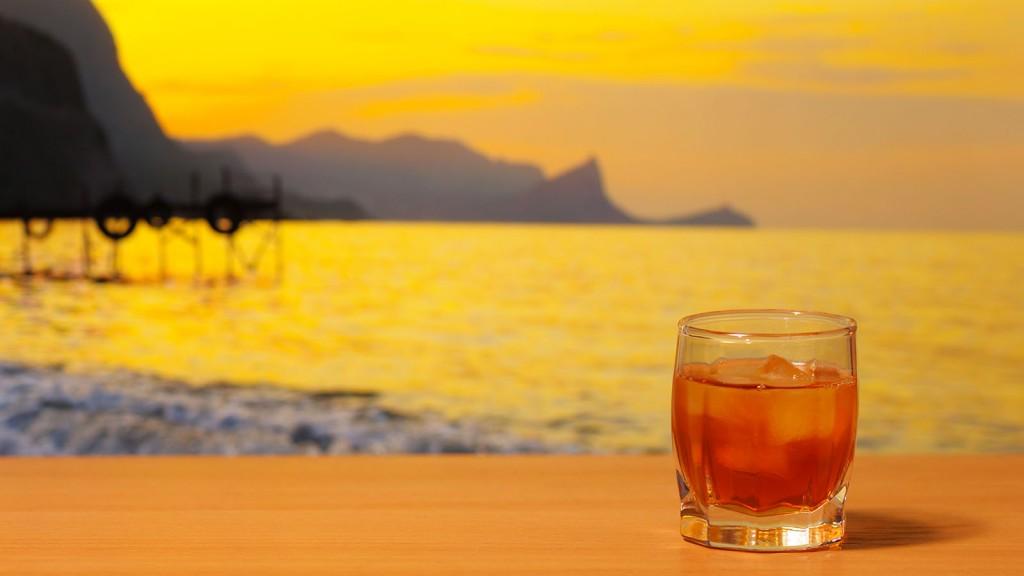 Glass of Brandy against sunset