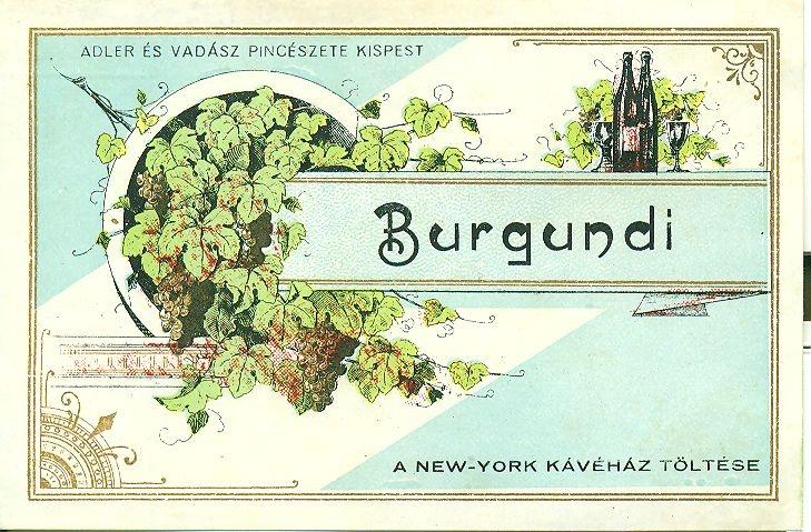 Fehér alapon arany keretben dús szőlő indák,borospalackok, poharakés fekete feliratok: A New York Kávéház költése Adler és Vadász Pincészete, Kispest