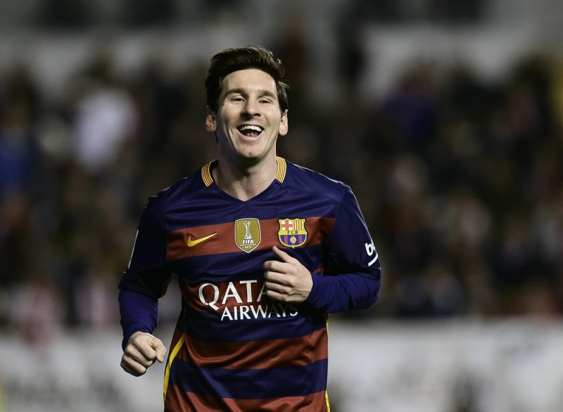 Barcelona's Argentinian forward Lionel Messi celebrates after scoring during the Spanish league football match CF Rayo Vallecano vs FC Barcelona at the Vallecas stadium in Madrid on March 3, 2016. / AFP / PIERRE-PHILIPPE MARCOU