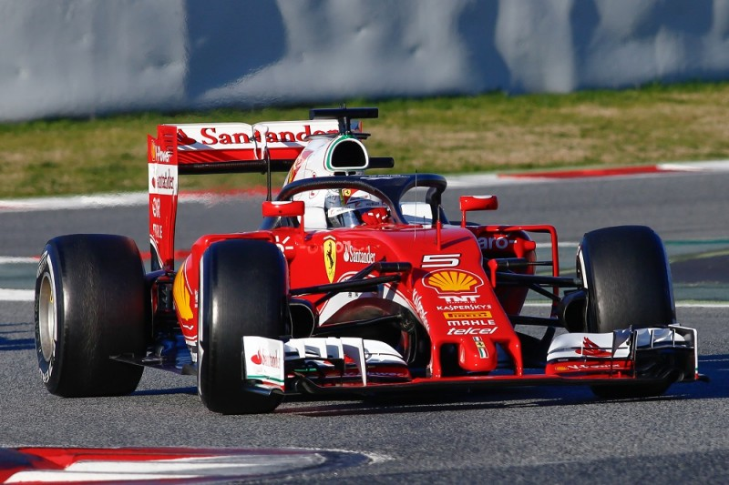 Ferrari's German driver Sebastian Vettel drives a car sporting a prototype protective cage over the cockpit, dubbed Halo, at the Circuit de Catalunya on March 4, 2016 in Montmelo on the outskirts of Barcelona during the fourth day of the second week of tests for the Formula One Grand Prix season. It is understood that the International Motorsport Federation (FIA) wants Grand Prix teams to run with a new 'Halo' design on their cars.   / AFP / Eric Alonso