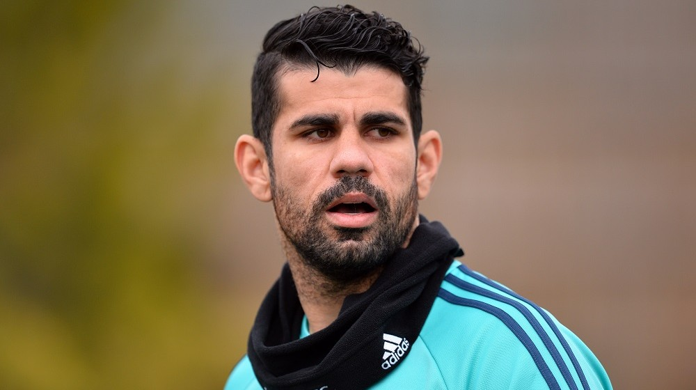 Chelsea's Brazilian-born Spanish striker Diego Costa arrives for training at Chelsea's Cobham training facility in Stoke D'Abernon, southwest of London, on March 8, 2016 ahead of their UEFA Champions League, round of 16 second leg football match against Paris Saint Germain.    / AFP / GLYN KIRK