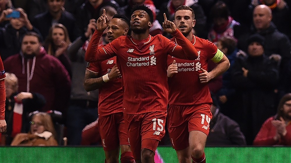 Liverpool's English striker Daniel Sturridge (C) celebrates scoring his team's first goal from the peanlrty spot during the UEFA Europa League round of 16, first leg football match between Liverpool and Manchester United at Anfield in Liverpool, northwest England on March 10, 2016. / AFP / PAUL ELLIS