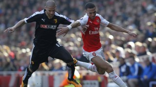 Watford's French midfielder Adlene Guedioura (L) vies with Arsenal's English defender Kieran Gibbs during the English FA Cup quarter final football match between Arsenal and Watford at the Emirates Stadium in London on March 13, 2016.  Watford won the game 2-1. / AFP / Ian Kington / RESTRICTED TO EDITORIAL USE. No use with unauthorized audio, video, data, fixture lists, club/league logos or 'live' services. Online in-match use limited to 75 images, no video emulation. No use in betting, games or single club/league/player publications.  /
