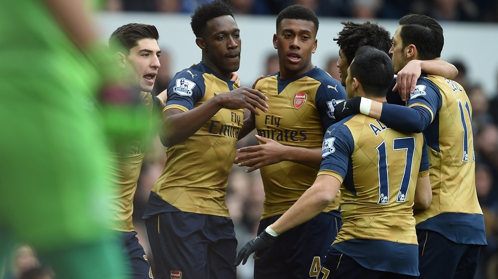 Arsenal's English striker Danny Welbeck (2nd L) celebrates with teammates after scoring the opening goal of the English Premier League football match between Everton and Arsenal at Goodison Park in Liverpool, north west England on March 19, 2016. / AFP / Paul ELLIS / RESTRICTED TO EDITORIAL USE. No use with unauthorized audio, video, data, fixture lists, club/league logos or 'live' services. Online in-match use limited to 75 images, no video emulation. No use in betting, games or single club/league/player publications.  /