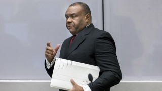 Former DRCongo leader Jean-Pierre Bemba Gombo arrives in a court room of the ICC to hear the delivery of the verdict against him blamed for unbridled rapes and killings by his private army in neighbouring Central African Republic over a decade ago, on March 21, 2016 in The Hague. International judges on March 21, 2016 found former Congolese vice president Jean-Pierre Bemba guilty on all five counts of war crimes and crimes against humanity. / AFP / ANP / Jerry Lampen / Netherlands OUT
