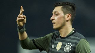 Germany's midfielder Mesut Oezil gestures during the friendly football match Germany v England at the Olympic Stadium in Berlin on March 26, 2016. England won the match 2-3. / AFP / ODD ANDERSEN