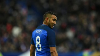 France's forward Dimitri Payet reacts during the international friendly football match between France and Russia at the Stade de France in Saint-Denis, north of Paris, on March 29, 2016. France won the match 4-2.  / AFP / FRANCK FIFE
