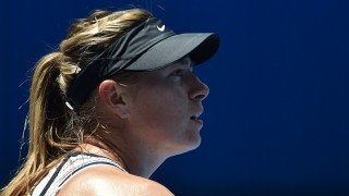 Russia's Maria Sharapova looks on during her women's singles match against Serena Williams of the US on day nine of the 2016 Australian Open tennis tournament in Melbourne on January 26, 2016. AFP PHOTO / SAEED KHAN  / AFP / SAEED KHAN