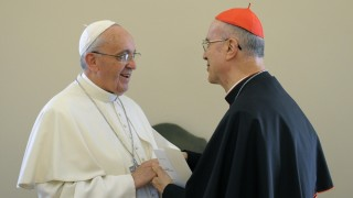 """This handout picture released on October 15, 2013 by the Vatican press office shows Pope Francis speaking with Vatican Secretary of State Cardinal Tarcisio Bertone (R) during a farewell ceremony at the Vatican. The Vatican began a new chapter today with scandal-hit cardinal Tarcisio Bertone stepping down as right-hand man to Pope Francis and replaced by veteran diplomat Pietro Parolin.  AFP PHOTO / OSSERVATORE ROMANO/HO  RESTRICTED TO EDITORIAL USE - MANDATORY CREDIT """"AFP PHOTO / OSSERVATORE ROMANO"""" - NO MARKETING NO ADVERTISING CAMPAIGNS - DISTRIBUTED AS A SERVICE TO CLIENTS / AFP / OSSERVATORE ROMANO / -"""