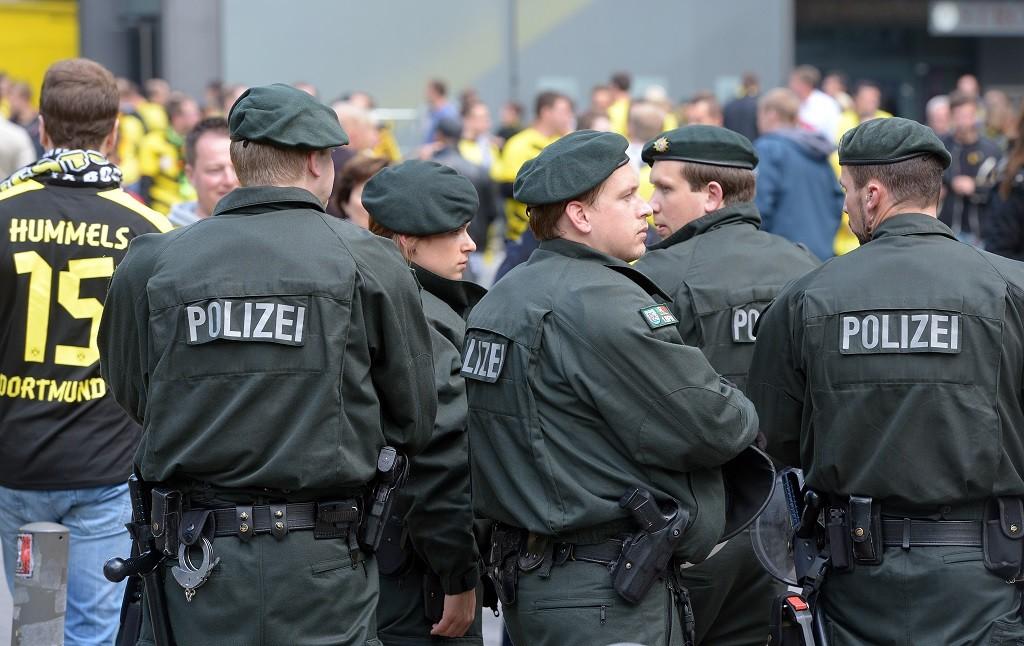 Police officers patrol the crowds before the German Bundesliga match betweenBorussia Dortmund and BayerLeverkusen at Signal-Iduna-Park in Dortmund, Germany, 23 August 2014. Photo:FEDERICOGAMBARINI/dpa