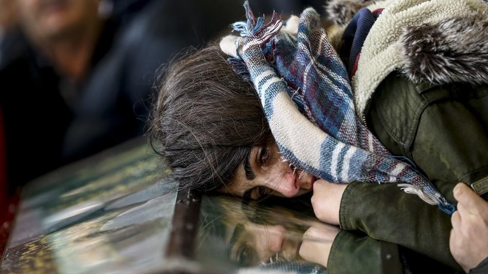 ANKARA, TURKEY - MARCH 14: A relative of Muharrem, Bagdat and Perihan Cermik, who were killed in Ankara terror attack, cries during a funeral ceremony at the Karsiyaka Cemetery Mosque in Ankara, Turkey on March 14, 2016.  Fatih Aktas / Anadolu Agency
