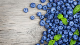 Blueberry on old wood background