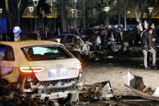 This picture taken on March 13, 2016, shows burnt out cars after a blast in Ankara.An explosion ripped through a busy square in central Ankara on March 13, killing 25 people and wounding 75 more, with local media reports describing it as an attack. Ambulances rushed to the scene of the explosion on Kizilay square, a key shopping and transport hub close to the city's embassy area. / AFP / ADEM ALTAN