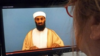 """An AFP editor looks at Osama Bin Laden appearing in a video document linked to """"Bin Laden's Bookshelf,"""" a package of declassified material posted on the website of the Office of the Director of National Intelligence May 20, 2015 in Washington, DC. In the unreleased video Bin Laden appears to stumble delivering a speech. The CIA declassified an Al-Qaeda recruitment form and around 100 other documents from Bin Laden's archive on May 20, 2015, allowing an insight into his thinking in his final years. The documents were among intelligence materials seized by US commandos on May 2, 2011 after they stormed Bin Laden's hideout in the Pakistani town of Abbottabad and shot him dead. AFP PHOTO / AFP / EVA HAMBACH"""